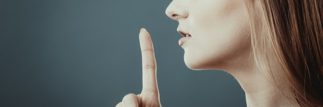 Closeup woman asking for silence or secrecy with finger on lips hush hand gesture, on blue background