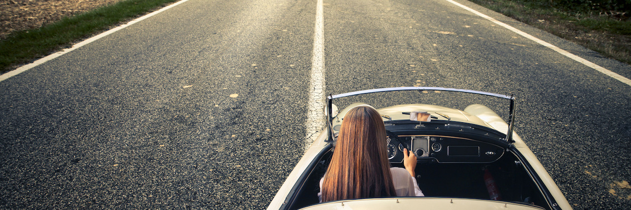A woman drive her car on a long journey
