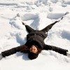 woman making a snow angel