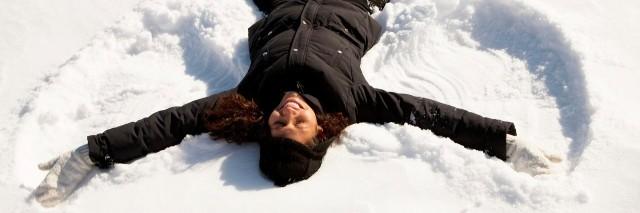 woman making a snow angel