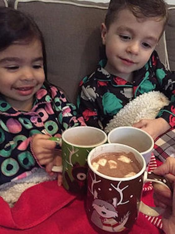 two children drinking hot chocolate