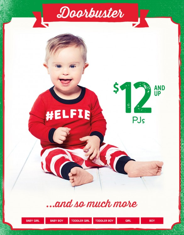Photo of Asher Nash wearing a sweater that says #Elfie