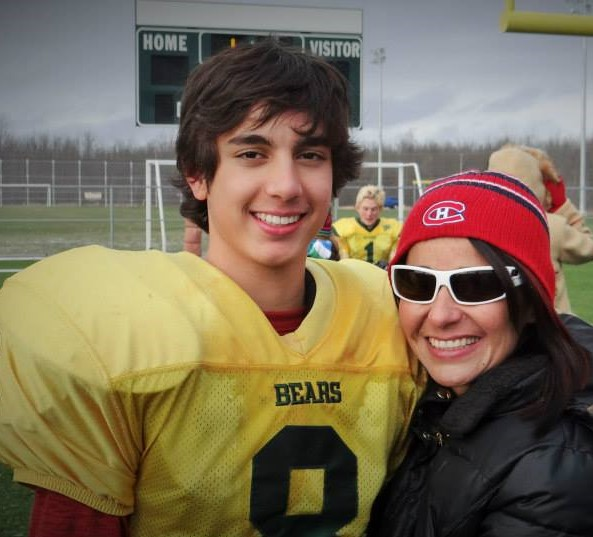 mother and son at a football game