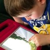Boy using Google Street Maps view on iPad