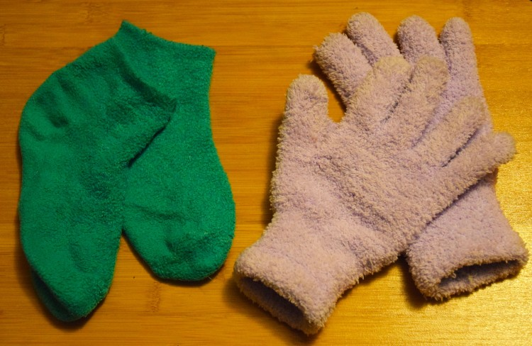 green fuzzy socks and pink fuzzy gloves