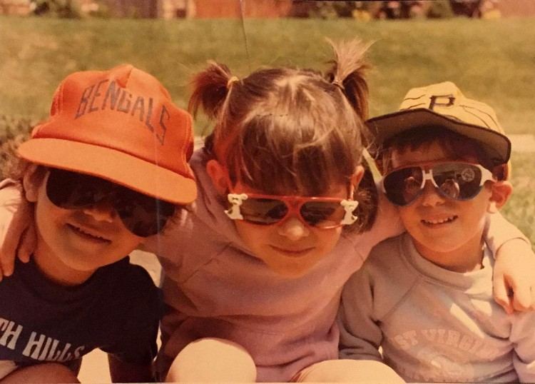 An old photo of the author and her two younger siblings wearing sunglasses