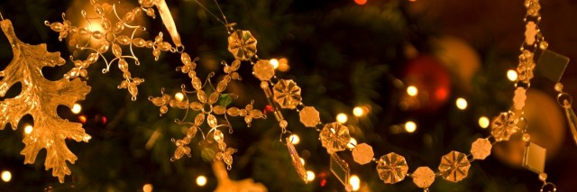 close up of golden ornaments on a christmas tree
