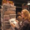 Woman At Newsstand