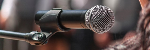 close up of microphone at a conference meeting