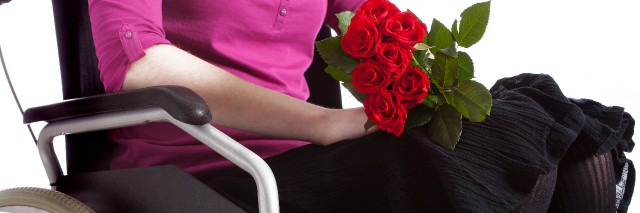 Woman in a wheelchair with roses.