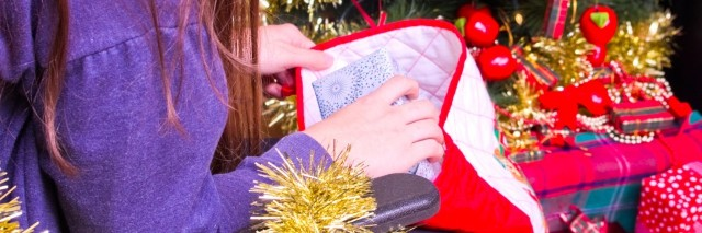 girl in wheelchair taking presents out of a christmas stocking