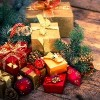 Christmas gifts and ornaments on wooden background