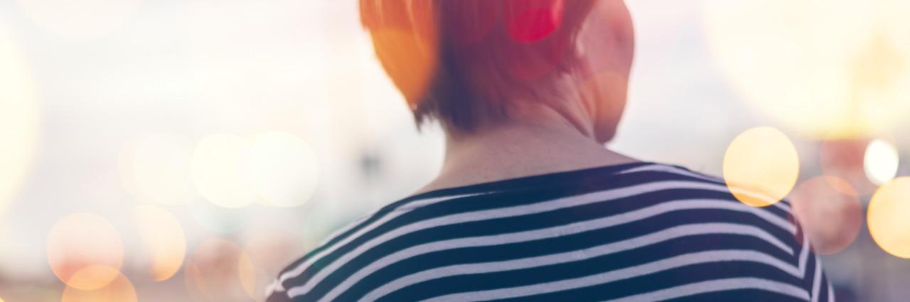 Woman walking on street, wearing striped long-sleeve shirt