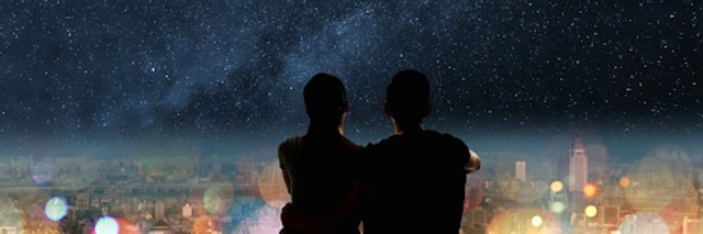 young couple looking at starry sky