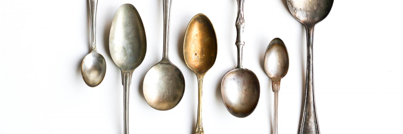 Antique Silver Spoons on White Background