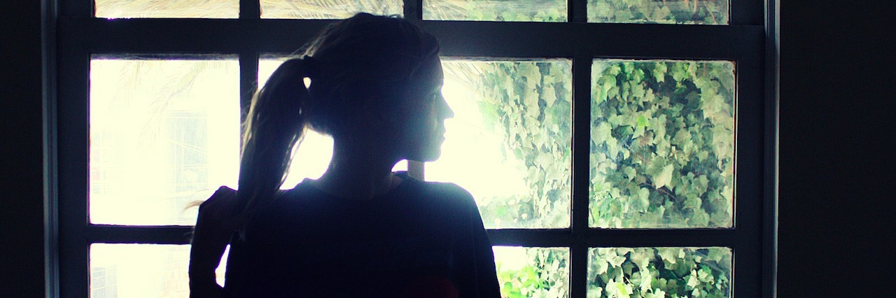 woman standing by a window