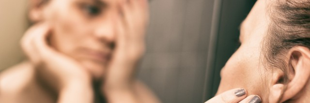 Mirror reflection of depressed woman