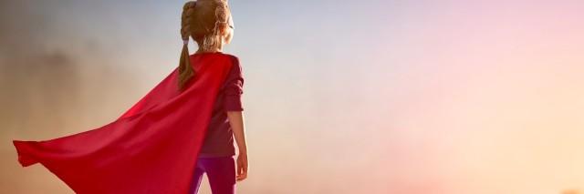 girl dressed as superhero on building roof
