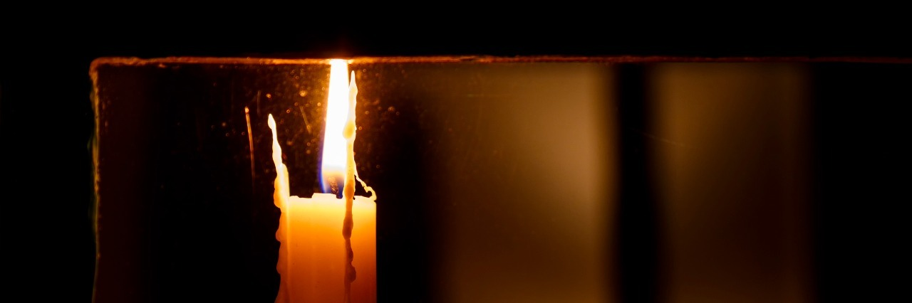 candle lit in a window