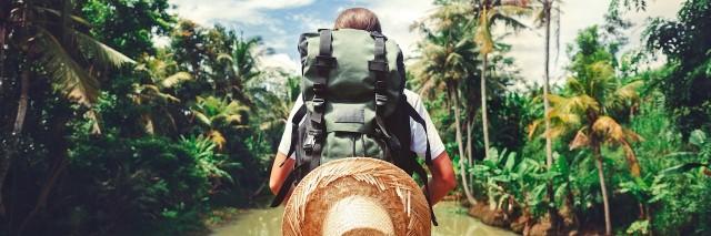 Woman standing near big tropical river