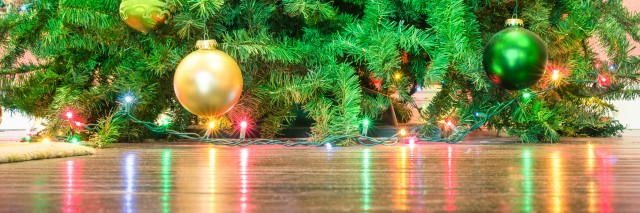 Detail of Christmas tree decorations with lights reflections
