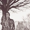 woman standing in front of a tree