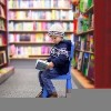 adorable little boy sitting in a book store
