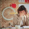 woman getting a Headache In Office