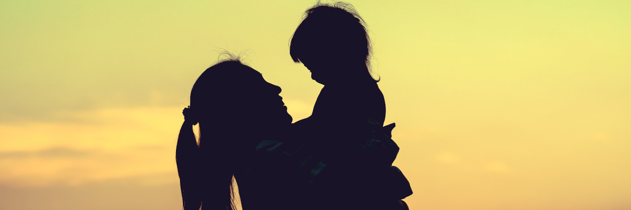Silhouette of mother and daughter.