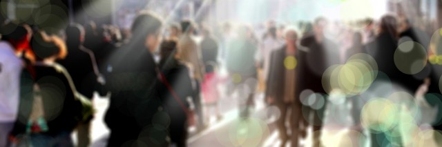 blurry background of people walking on a busy street