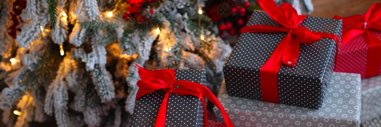 christmas gifts by the tree and decorations