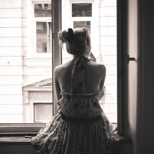 Sepia, black and white, woman in the window