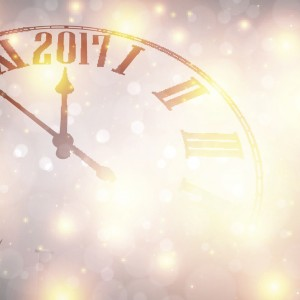 2017 New Year shining background with clock.