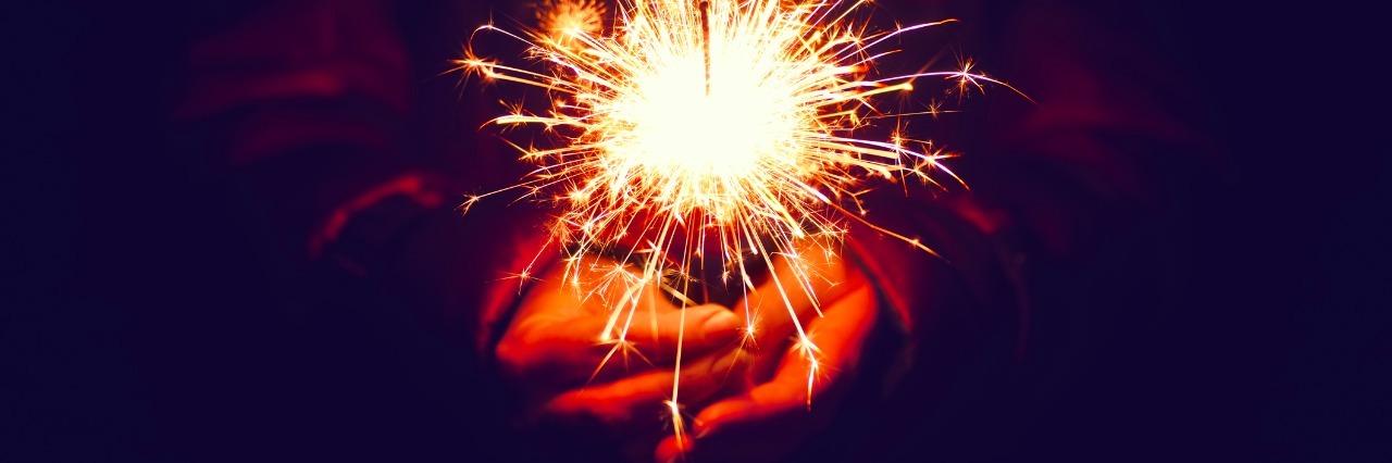 festive christmas sparkler in hand