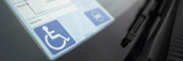 handicap sticker on windshield