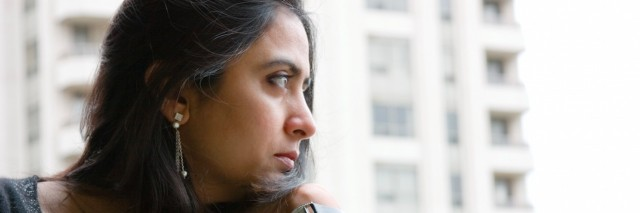 Woman looking pensive while looking out of the window