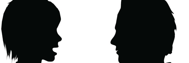 Silhouette of woman talking to man