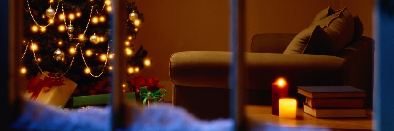 a view inside a living room with a christmas tree