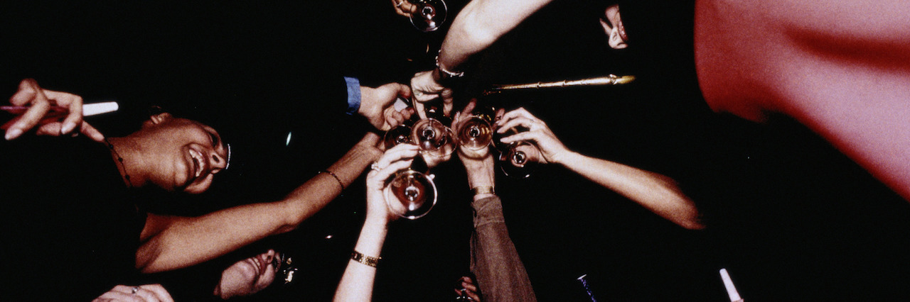 a group of friend's making a toast