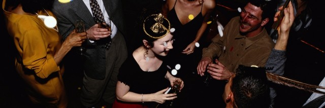 people celebrating the new year at a party