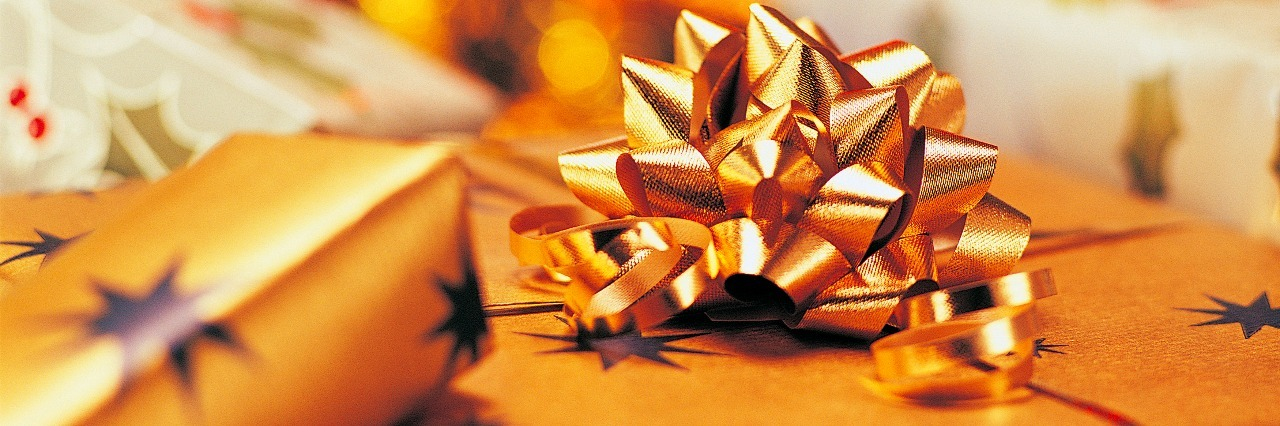 presents wrapped in gold paper