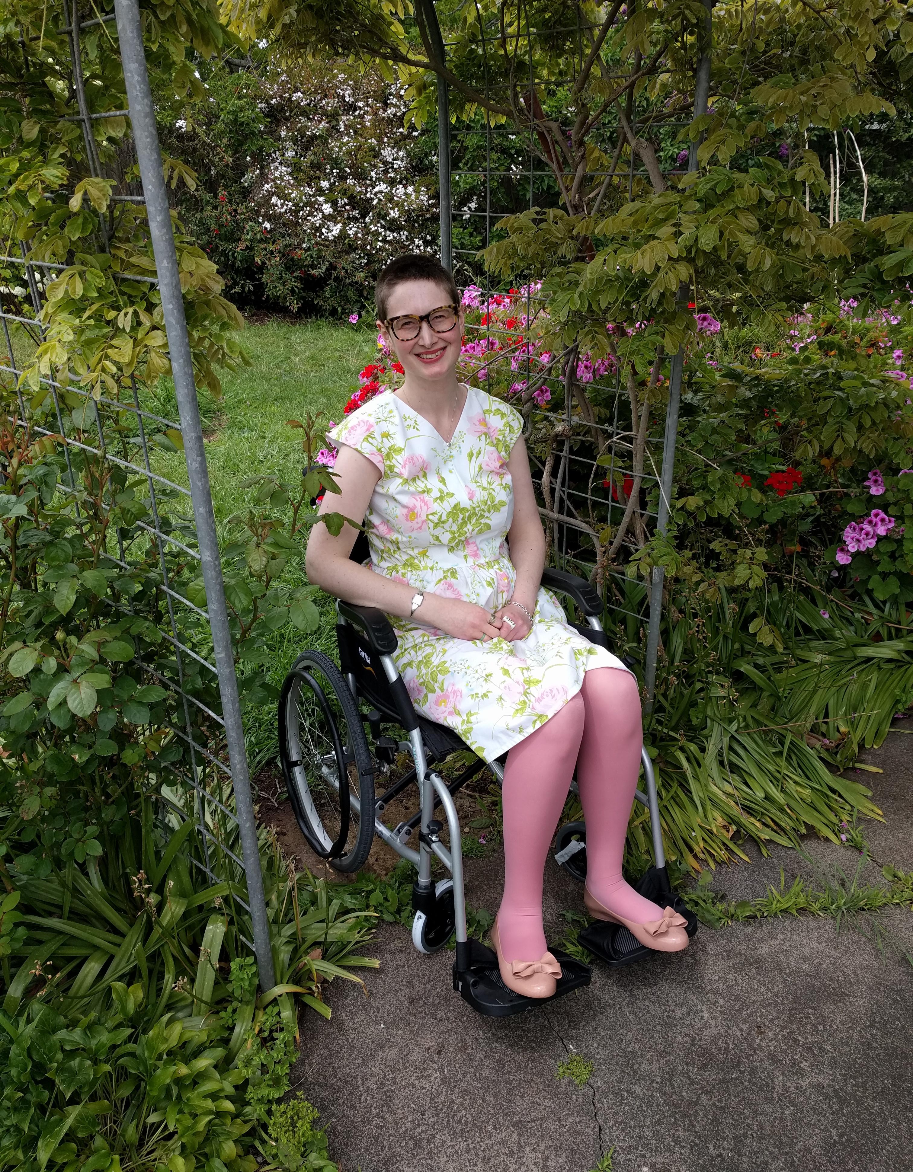 woman in wheelchair in a garden