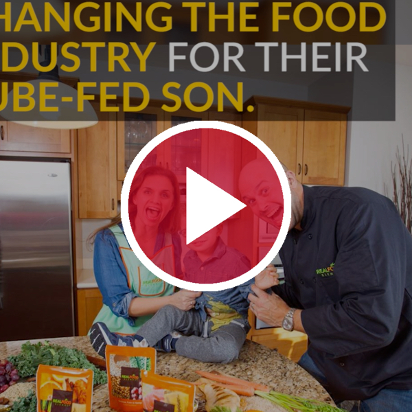 family displaying tube feeding product behind red video play button