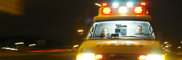 an ambulance rushing with its lights flashing