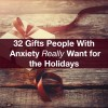 a gift sitting on a wooden table. Text reads: 32 gifts people with anxiety really want for the holidays