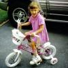 Amelia riding her bike.