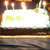 Birthday cake with birthday candles lit