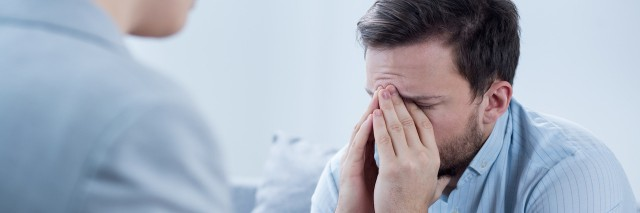 Man with depression crying during psychotherapy session