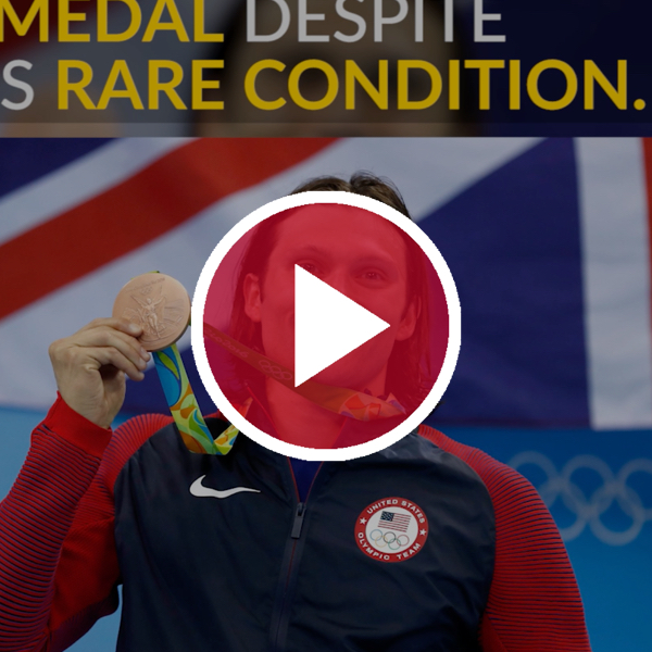 cody miller with olympic medal behind red video play button
