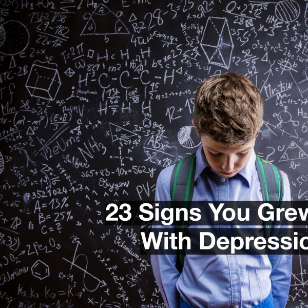 young boy wearing a backpack standing in front of a blackboard with his head down. Text reads: 23 signs you grew up with depression